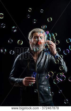 Soap Bubbles. Bearded Man Blowing Bubbles. Play With Bubbles. Bearded Man Blowing Soap Bubbles. Happ