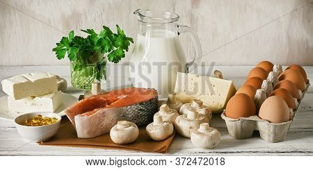 Vitamin D Rich Foods On A White Wooden Table, Banner. Natural Sources Of Vitamin D Are Dairy Product