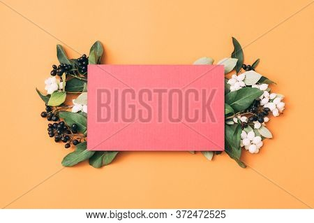 Greeting Card Mockup. Special Occasion. Floral Decorative Composition. Orange Background.
