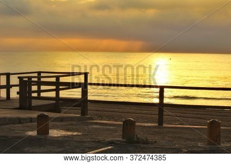 Beautiful Sunrise On The Beach With Pink And Golden Colors In Arenales Del Sol, Alicante,southern Sp