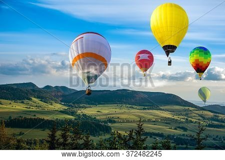 Balloon Against The Background Of Sun Dawn . Beam Of The Sun .  Balloons Fly In Clouds Of Clear Sky.