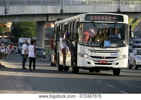 Salvador, Bahia / Brazil - February 4, 2015: Young People Are Seen Grabbing The Doors Of Public Tran
