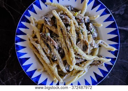 Homemade Trofie Pasta With Delicious Mushrooms And Ricotta