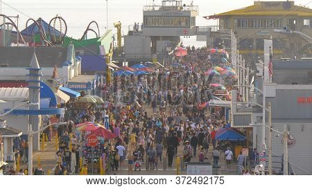Santa Monica Pier Is A Busy Place In The City With Thounited Statesnds Of Visitors - Los Angeles, Un