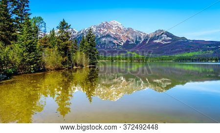 Reflection Of Pyramid Mountain In Pyramid Lake In Jasper National Park In Alberta, Canada. The Mount