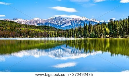 Reflection Of The Colin Mountain Range In Pyramid Lake In Jasper National Park In Alberta, Canada. T