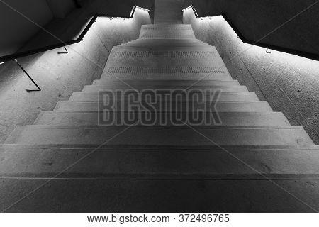 Illuminated Old Stairway In The Dark In Monochrome