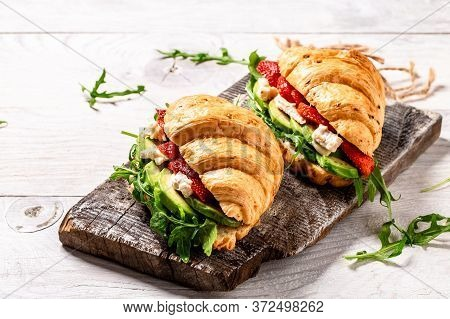 Tasty Breakfast Wholegrain Croissant Sandwich With Strawberries, Arugula, Avocado And Brie, Camember