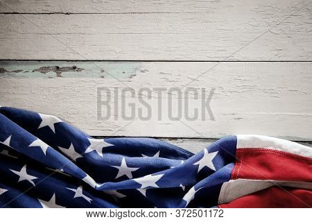 Usa Flag Lying On Vintage Weathered Wooden Background. American Symbolic. 4th Of July Or Memorial Da