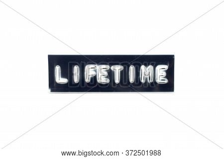 Embossed Letter In Word Lifetime On Black Banner With White Background