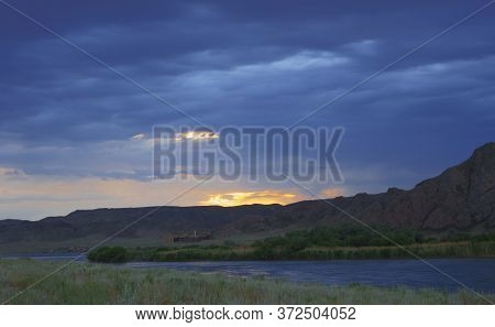 Landscape In The Steppe, Prairie. Landscape In The River Valley, Mountains. An Epic Moment In Nature