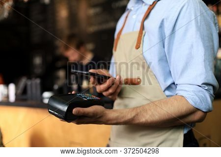 Customer Using Credit Cart For Payment To Owner At Cafe Restaurant, Cashless Technology And Credit C