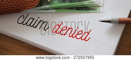 Claim Denied Words On Copybook Page, 100 Euro Bills, . Insurance Payment Reject Concept. Business Co