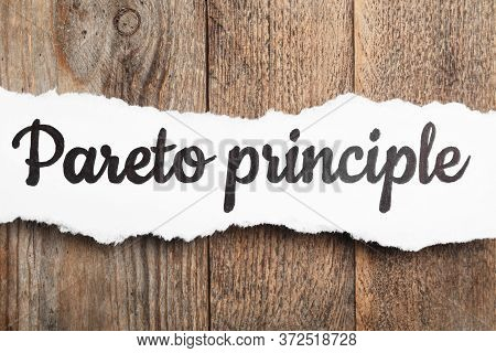 Sheet Of Paper With Words Pareto Principle On Wooden Background, Top View