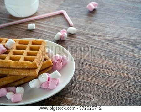 Background With Food And Copy Space. On A Wooden Table Is A Plate With Rectangular Cookies And Sweet