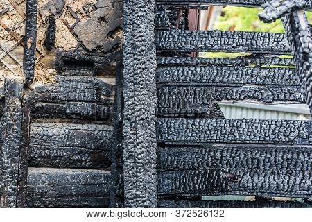 Part Of The Charred Wooden Wall Of An Apartment Building After A Fire Closr Up