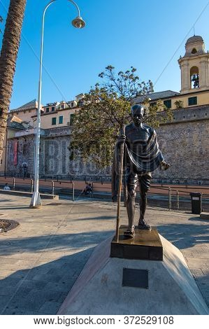 Genoa, Italy - August 18, 2019: The Bronze Statue Of Mahatma Gandhi In The Promenade Of Porto Antico