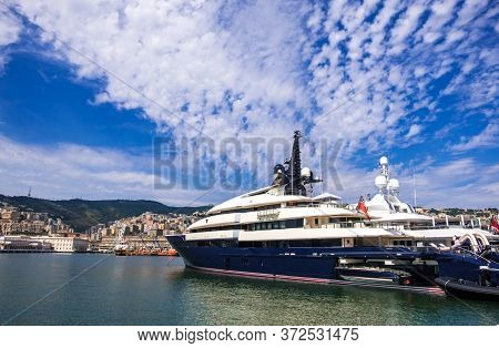 Genoa, Italy - August 20, 2019: Luxury Yacht In The Porto Antico Di Genova Or Old Port Of Genoa, Lig
