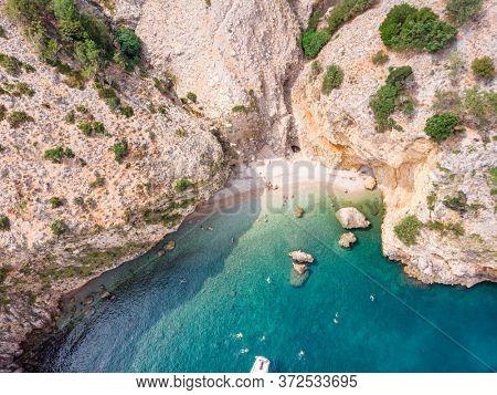 The bird's eye view on bay in the rocky coastline of the Adriatic sea. The island Cres, Croatia. Adriatic.  September 2019