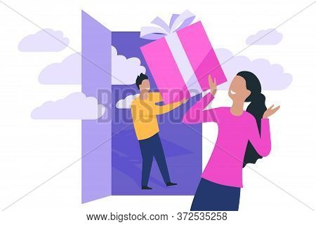 Gift Giving Concept - Boyfriend Stay In Doorway And Gives A Present Box To His Girlfriend - Romantic
