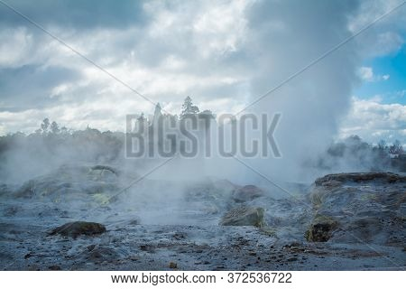Geyser Field With Active Geysers Amongst Rocks