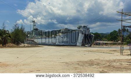 Koh Phangan, Thailand- April 18 2019: Island Pier Old Under Construction Grey Ship