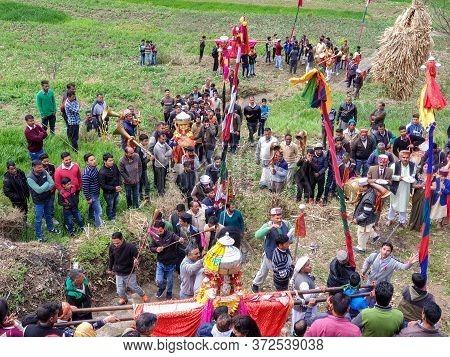 Mandi, Himachal Pradesh / India - March 01 2020: Hindu Culture Of North India: People Lifting Chario