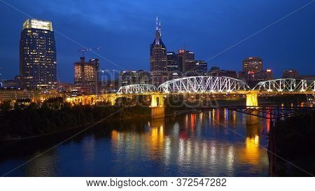 City Of Nashville And Pedestrian Bridge By Night - Nashville, Usa - June 17, 2019