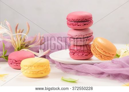 A French Sweet Delicacy, Macaroons Variety Closeup. Color Fresh Macarrons On Wooden Background.