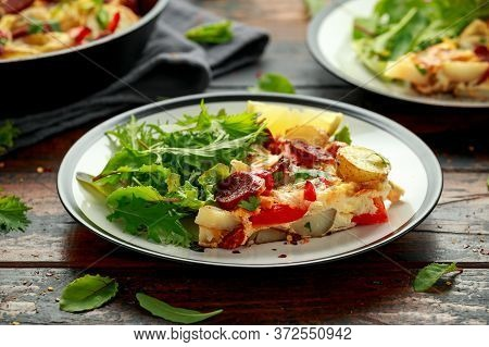 Chorizo Frittata With Salad On Black And White Plate. Healthy Morning Breakfast Food