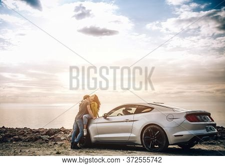 Romantic Young Couple Sharing A Special Moment While Outdoors. Young Couple In Love On A Road Trip.