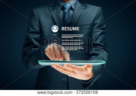 Human Resources Recruiter Read Resume On Digital Tablet. Recruiting And Searching Human Resources Co