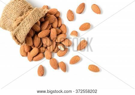 Almonds Nuts With Sack Isolated On White Background And Top View, Almonds Are Very Popular Nuts And
