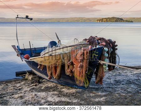 Traditional Fishermen Boat Docked On Marta Beach, A Little Medieval Village On Bolsena Lakeshore, Vi