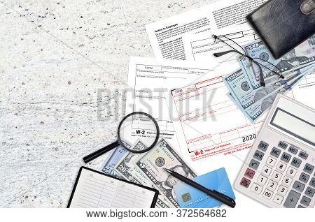 Irs Form W-2 Wage And Tax Statement Lies On Flat Lay Office Table And Ready To Fill. U.s. Internal R