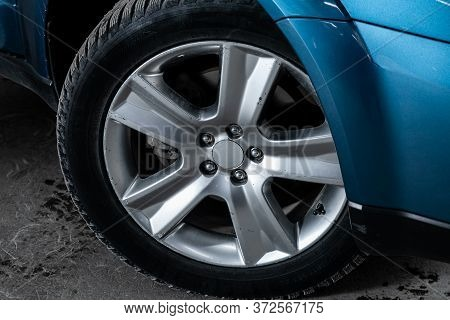 Novosibirsk/ Russia - March 23 2020: Subaru Outback, Car Wheel With Alloy Wheel And New Rubber On A