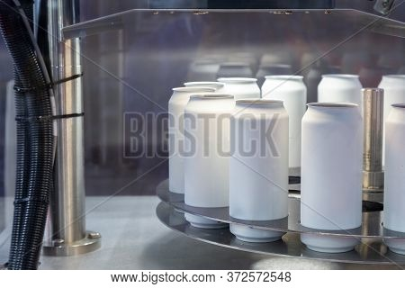 Empty New White Aluminum Cans For Drink Process Are Scanning And Moving In Factory Line On Conveyor