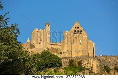 Beynac-et-Cazenac, France - August 15, 2019: The medieval Chateau de Beynac rising on a limestone cliff above the Dordogne River. Dordogne department, Beynac-et-Cazenac