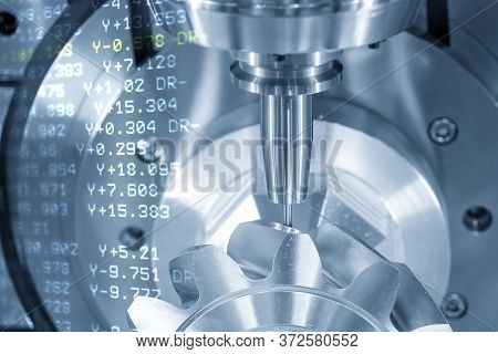 The Abstract Scene Of 5 Axis Cnc Milling Machine Cutting The Metal Gear Parts With Solid Ball Endmil