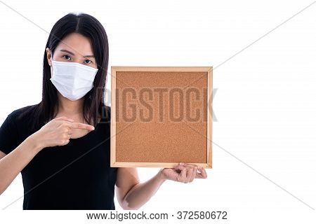 An Asian Woman Holding An Empty Board For Writing Covid-19 Prevention Isolated On White Background.