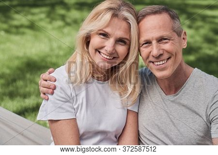 Merry Mature Spouses Spending Sunny Day In Nature