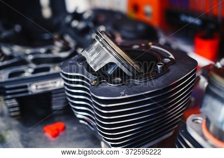 Part Of A Motorcycle Engine On A Table In A Workshop