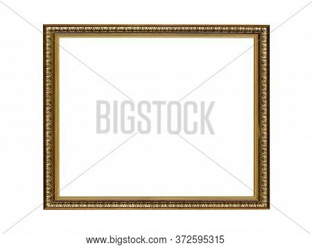 Old Empty Wooden Frame For Paintings With Gold Patina. Isolated On White Background