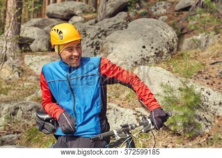 Portrait Of A Cyclist With A Mountain Bike On A Halt.