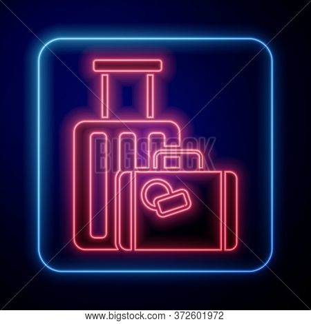Glowing Neon Suitcase For Travel Icon Isolated On Blue Background. Traveling Baggage Sign. Travel Lu