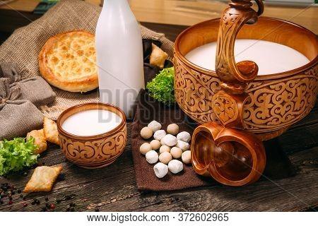 Kazakh National Traditional Cuisine Kumys Horse Milk With Sour Cheese Kurt, Horizontal