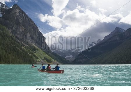 Canoeing In The Glacial Waters Of Lake Louise, Banff National Park, Canada.