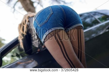 Female Prostitute Flirting Near The Client's Car.