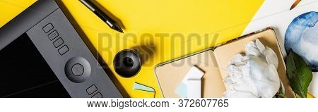 Panoramic Crop Of Painting, Drawing Tablet, Stylus, Notebook And Flower On Yellow