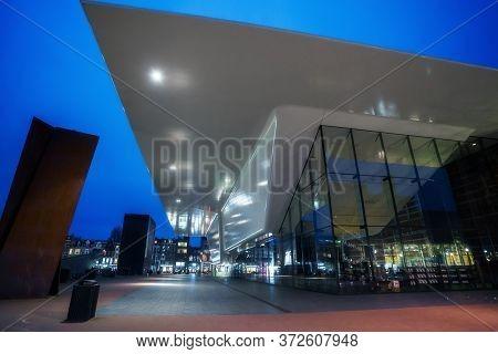 Amsterdam, Netherlands - March 7, 2020: Empty Streets Near Stedelijk Museum Illuminated At Night In